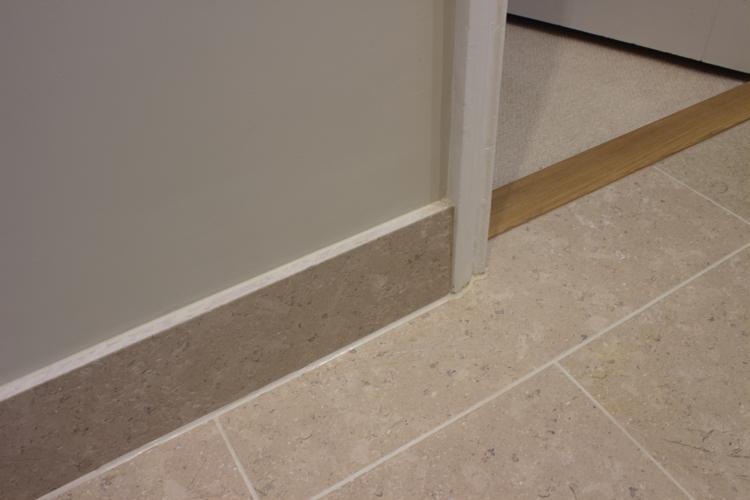 Tile and carpet meets door